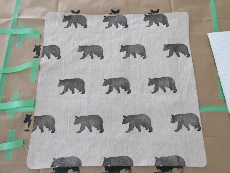 Bear pattern being stamped onto cotton twill